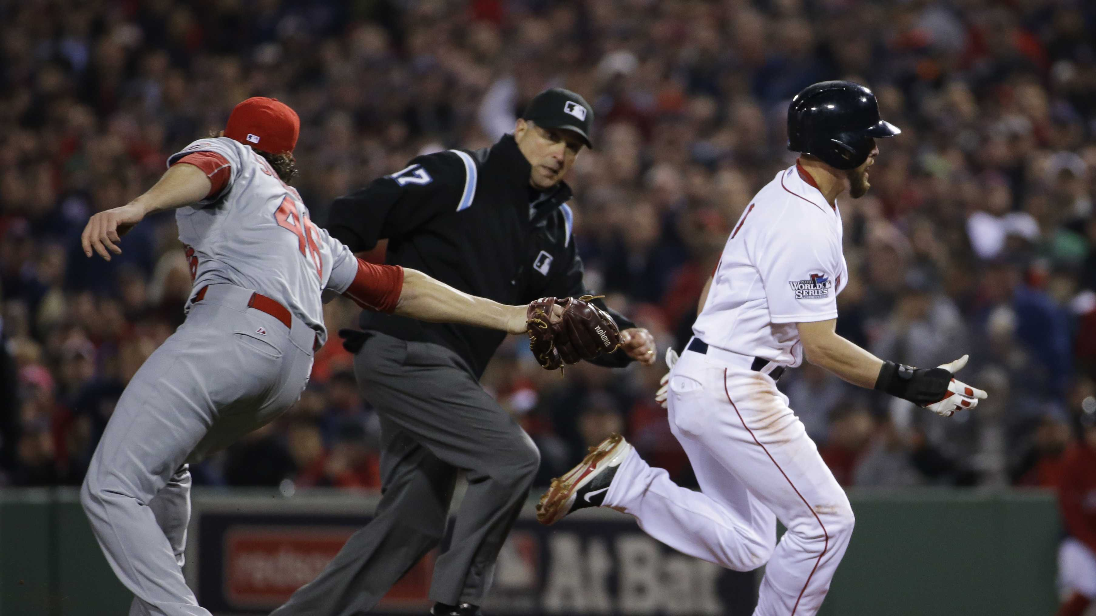 St. Louis Cardinals relief pitcher Kevin Siegrist, left, misses the tag on Boston Red Sox center fielder Jacoby Ellsbury (2) he makes it back to first on a run down during the fifth inning of Game 6 of baseball's World Series Wednesday, Oct. 30, 2013, in Boston.
