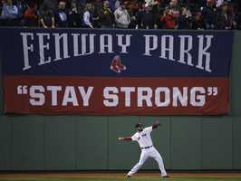Boston Red Sox starting pitcher John Lackey warms up before Game 6 of baseball's World Series against the St. Louis Cardinals Wednesday, Oct. 30, 2013, in Boston.
