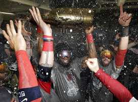 Boston Red Sox's David Ortiz celebrates with teammates after Game 6 of baseball's World Series against the St. Louis Cardinals Thursday, Oct. 31, 2013, in Boston. The Red Sox won 6-1 to win the series. Ortiz was names the series MVP.