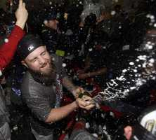 Boston Red Sox's Mike Napoli celebrates with teammates after Game 6 of baseball's World Series against the St. Louis Cardinals Thursday, Oct. 31, 2013, in Boston. The Red Sox won 6-1 to win the series.