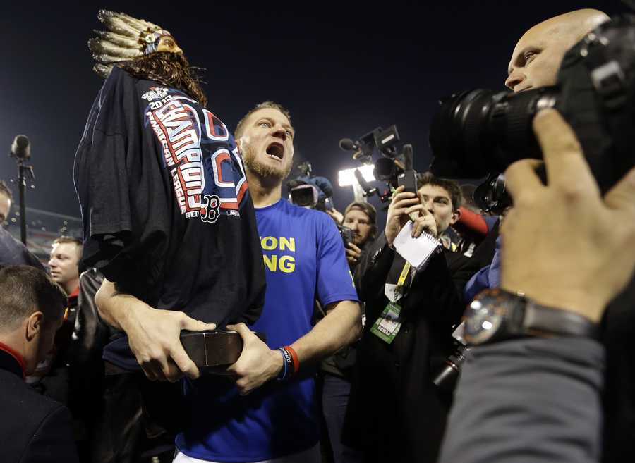 Boston Red Sox's Jake Peavy celebrates after Game 6 of baseball's World Series against the St. Louis Cardinals Thursday, Oct. 31, 2013, in Boston. The Red Sox won 6-1 to win the series.
