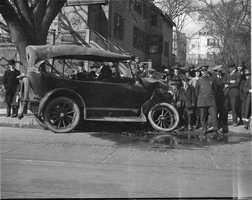 Wrecked auto and crowd in Boston in 1918