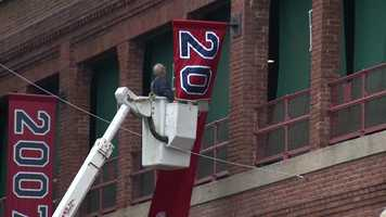 Click here to see video of workers putting up the banner.