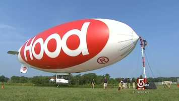 It takes a team effort to lift the Hood Blimp off the ground.