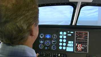 Much of the training occurs in the school's flight simulator.