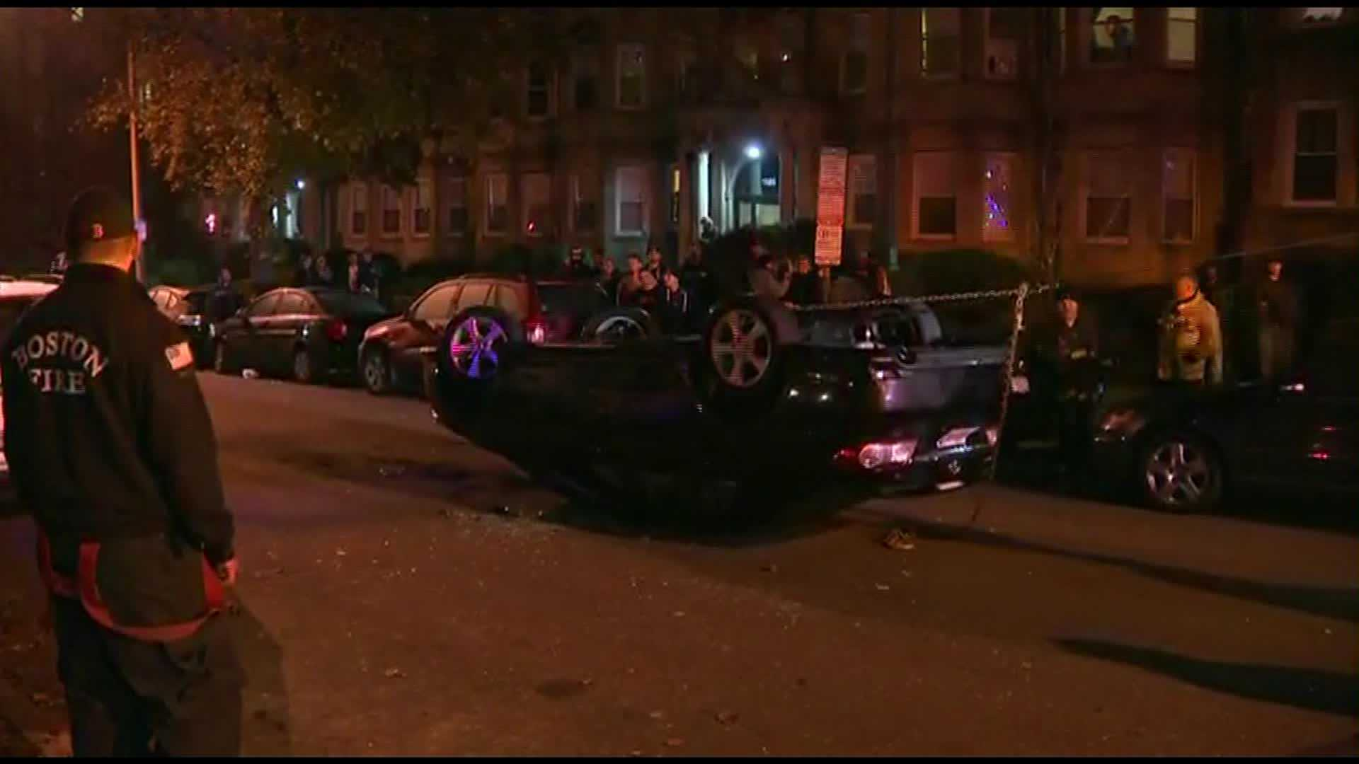 Car flipped in World Series vandalism 103113