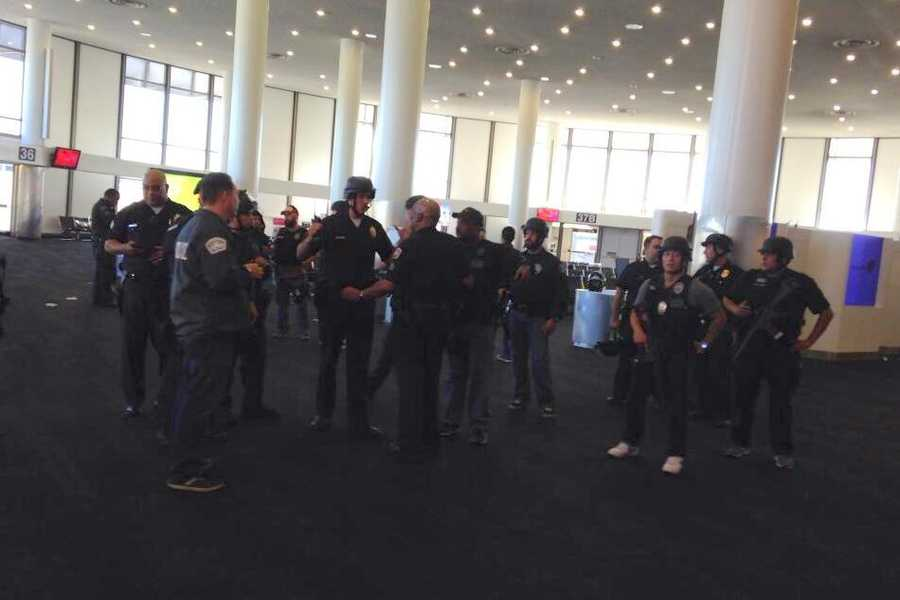 As gunshots rang out in Terminal 3, panicked fliers dropped to the ground.