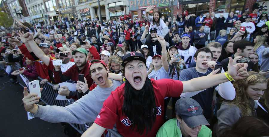 Boston Red Sox fans celebrate during a parade in celebration of the baseball team's World Series victoru, Saturday, Nov. 2, 2013, in Boston.