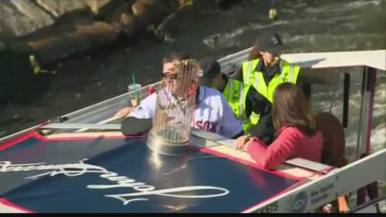img-Boston Red Sox manager John Farrell hoists World Series trophy on duck boat