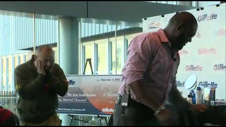 Red Sox players David Ortiz and Shane Victorino shaved in a promotion at Gillette headquarters in Boston.