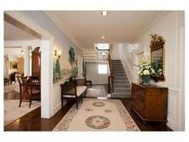 Built c.1913, this stately brick home has 15 beautiful rooms appointed with reclaimed chestnut flooring.