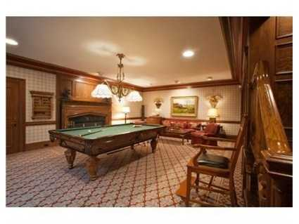 The lower level boasts a fireplaced billiard room.