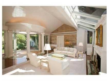 It has architectural columns, a fireplace, onyx & teak flooring.