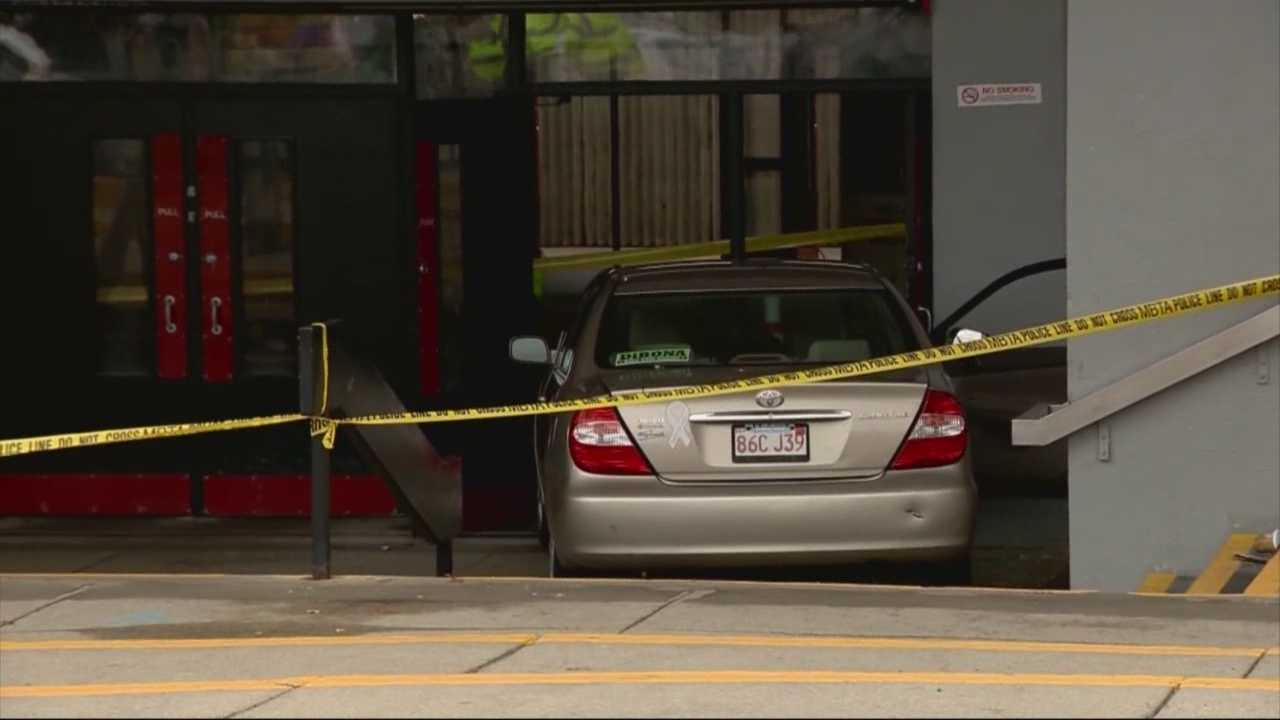 2 hurt when car drives into MBTA station