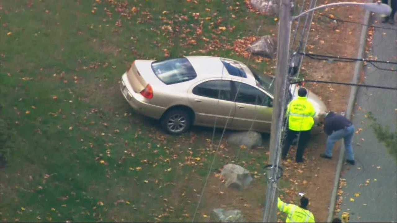 Toddler, mom hurt when unoccupied car rolls down driveway in Worcester.