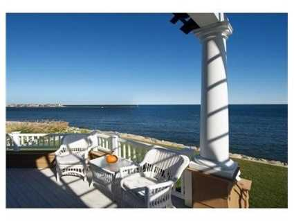 This shingle style home sits high overlooking the entrance to Scituate Harbor with frontage on the Atlantic Ocean.