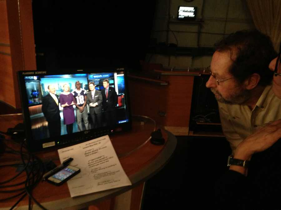 Lightning director Wayne Smith looks at the monitor as the PSA is recorded.