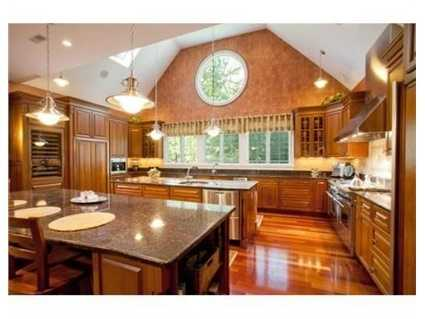 It hasgranite counters, 2 center islands and upscale appliances.