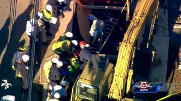 A construction worker has been pulled from an Ipswich trench after being trapped for several hours Tuesday.