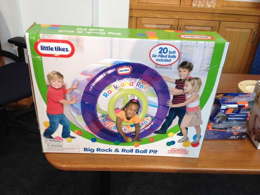 """Big Rock & Roll Ball Pit by The Little Tikes CompanyWATCH SAYS: Children as young as 3-years-old are encouraged to climb inside or push this rolling, inflatable ball pit. The manufacturer cautions that """"competent adult supervision is required ... """" however the box portrays unsupervised children at play."""