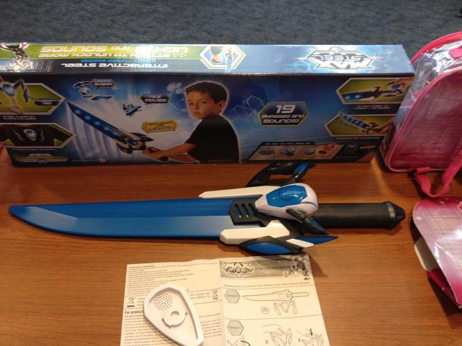 """Max Steel Interactive Steel With Turbo Sword by MattelWATCH SAYS: Young children are encouraged to """"attach steel to turbofy"""" this rigid plastic sword, measuring approximately 2 feet long. The blade has the potential to cause facial or other impact injuries."""
