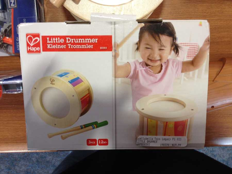 """Little Drummer by Hape ToysWATCH SAYS: This multi-colored drum is sold for babies as young as twelve-months-old. The manufacturer provides no warnings regarding the slender, rigid approximately 6 ½"""" long drumstick, which has the potential to be mouthed and occlude a child's airway."""