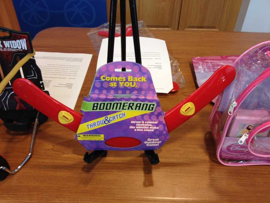 """Boomerang Throw and Catch by Kole ImportsWATCH SAYS: This rigid plastic boomerang incorporates whistles that """"make a bee sound"""" when thrown. The manufacturer cautions that the """"toy"""" should not be aimed at """"people and animals."""" Boomerangs should not be sold for children of any age."""