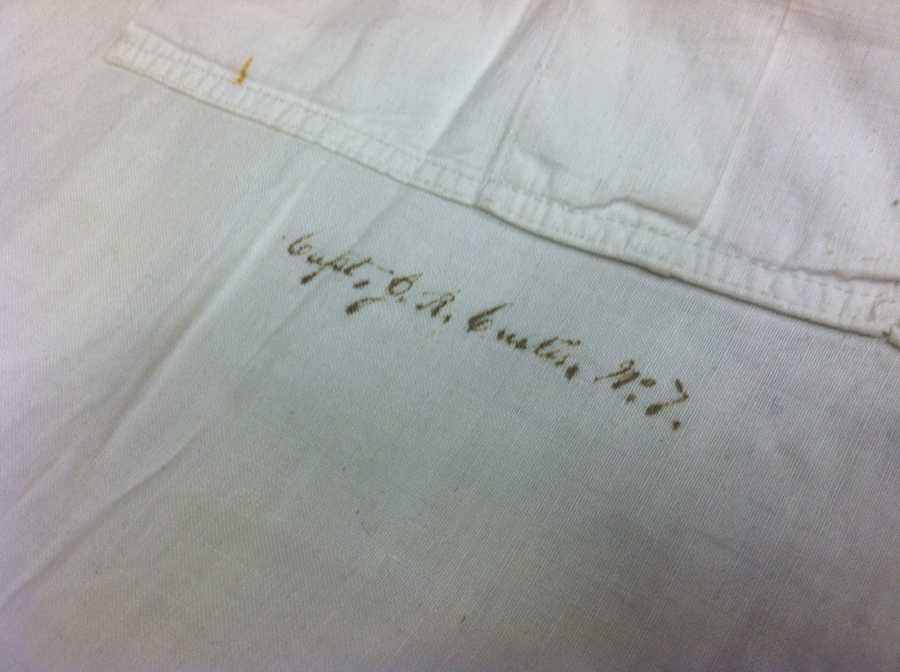 His signature is still visible on the front of the shirt.