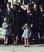 In this Monday, Nov. 25, 1963 file photo, 3-year-old John F. Kennedy Jr. salutes his father's casket in Washington, three days after the president was assassinated in Dallas. Widow Jacqueline Kennedy, center, and daughter Caroline Kennedy are accompanied by the late president's brothers Sen. Edward Kennedy, left, and Attorney General Robert Kennedy.
