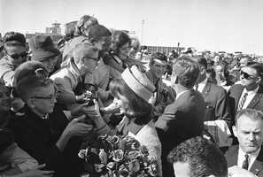 President John F. Kennedy and first lady Jacqueline Kennedy greet people on their arrival at the Dallas Airport (Love Field).