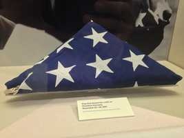 The flag that draped the coffin of John F. Kennedy on display at the JFK Library in Boston.