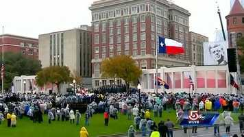 The memorial service in Dealey Plaza began in Dallas on Friday afternoon with bagpipers and the U.S. Naval Academy Men's Glee Club. The planed symphony music did not happen because of the inclement weather.