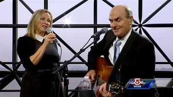 James Taylor and his wife, Kim, perform at the JFK Library in Boston.