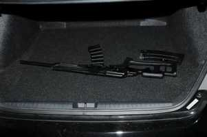 Shotgun in the trunk of the shooter's car