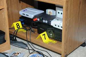 Numerous Xbox and Sony Playstation 2 games were found in the cabinet of the computer room.