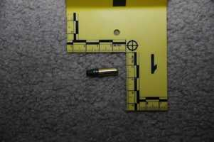 A .22 caliber bullet found on the floor of the computer room.