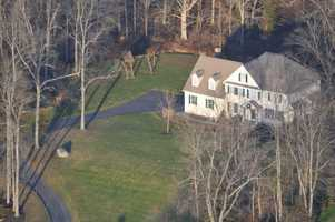 Photos of the home 20-year-old shooter Adam Lanza shared with his mother in Newtown, Conn. were released Monday along with photos outside Sandy Hook Elementary School.