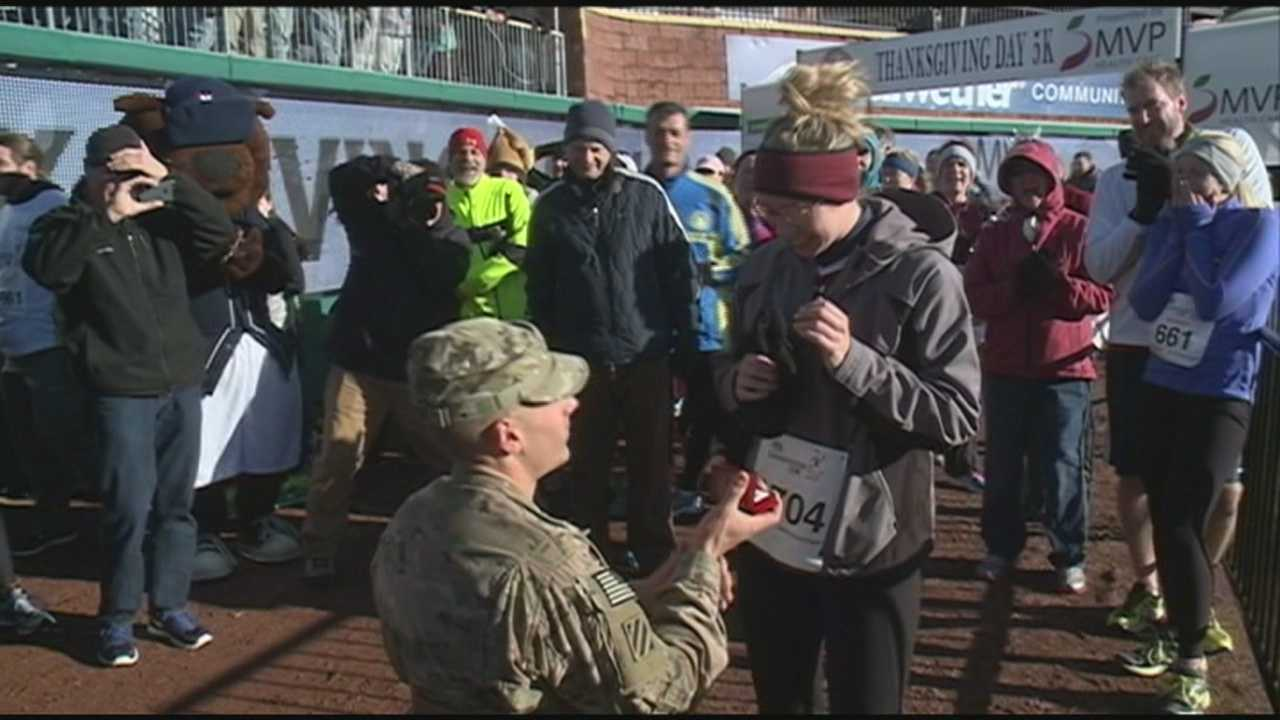 A Bedford woman got a big surprise at the finish line of the Turkey Trot on Thanksgiving, where her boyfriend, Army Specialist Jeff Glaude, was waiting for her.