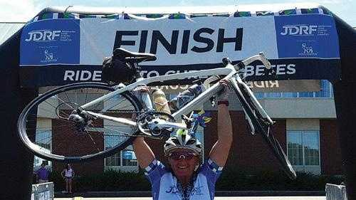 Wendy Lampro, of Otis, rides her bike in races all over the United States in order to raise money to fight Type 1 diabetes. Her sister died of complications from the disease in 2003.