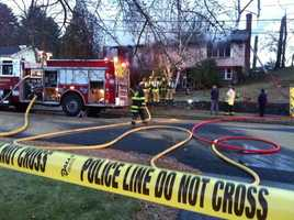 Flames engulfed the home, but no injuries were reported.