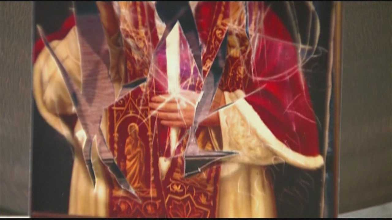Boston police are looking to identify vandals who broke into a Brighton church and defaced a painting of the pope.