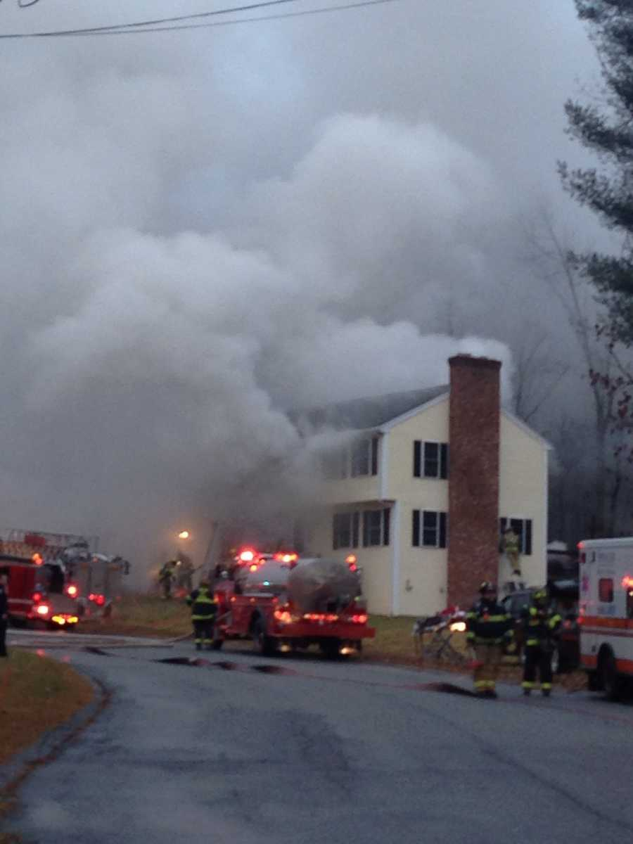 The three-alarm fire broke out shortly after 7 a.m. on Joanna Drive.