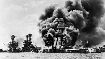 """74 years ago, Pearl Harbor was attacked by the Japanese in a devastating surprise air strike. 2,402 Americans were killed and 1,282 wounded. FDR called it a """"day which will live in infamy,"""" and it forced the US to enter WWII."""