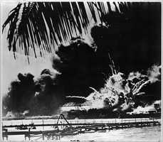 Pearl Harbor naval base and U.S.S. Shaw ablaze after the Japanese attack