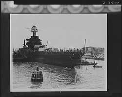 Pearl Harbor bombing. Drydock bound. The USS West Virginia, sunk at her berth by Japanese torpedoes and bombs during the surprise attack on Pearl Harbor, was raised sufficiently to enable her to be towed to drydock. She is shown here being maneuvered by tugs, preliminary to the start of repairs