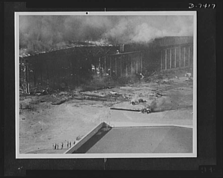 Pearl Harbor bombing. Hangar fire. Japanese bombs wrecked and fired this hangar at the U.S. naval air station, Pearl Harbor, in addition to causing extensive damage to planes on the apron and runways, several of which may be seen in the foreground
