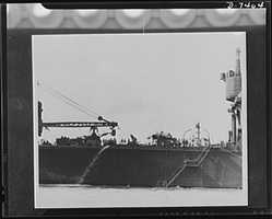 Pearl Harbor bombing. USS Curtiss.Wreckage of Japanese plane, which crashed into one of the cranes, may still be seen on the deck of the U.S. seaplane tender, Curtiss. In addition, the Curtiss was damaged by a bomb explosion on the main deck in the forward part of a hangar. All damage has since been repaired