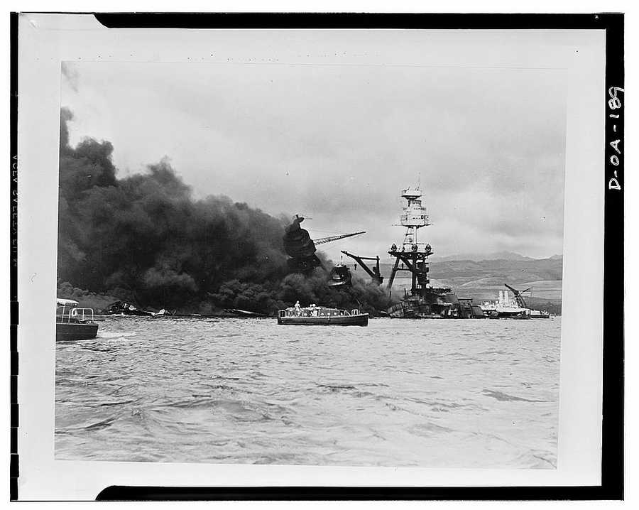 USS Arizona, at height of fire, following Japanese aerial attack on Pearl Harbor, Hawaii