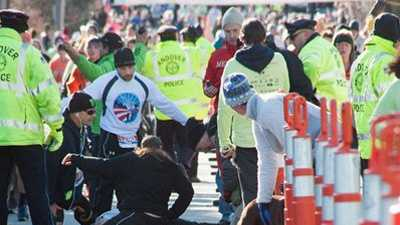 Medical personnel work on Alan Dewhirst after he suffered a heart attack near the end of the Feaster Five road race on Thanksgiving morning in Andover.