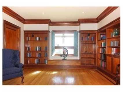 The library features glass cabinetry.
